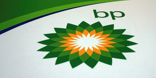 BP beats earnings forecast, boosts dividend despite weak prices